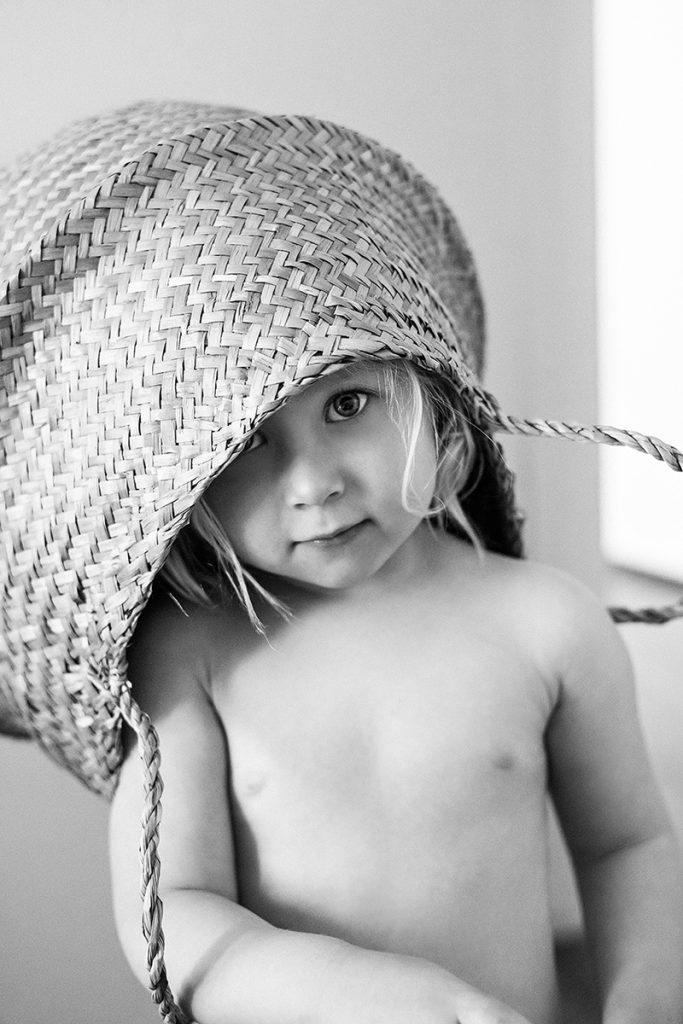 toddler-girl-with-basket-on-head