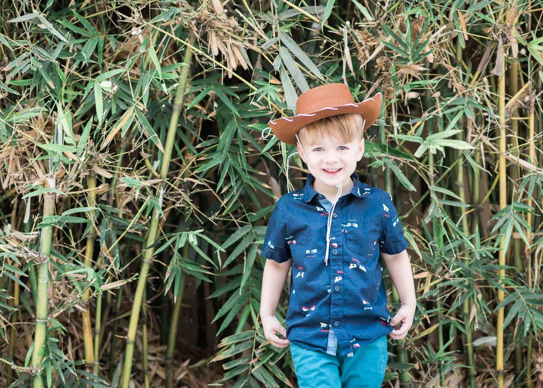 Candid portrait of boy in hat.