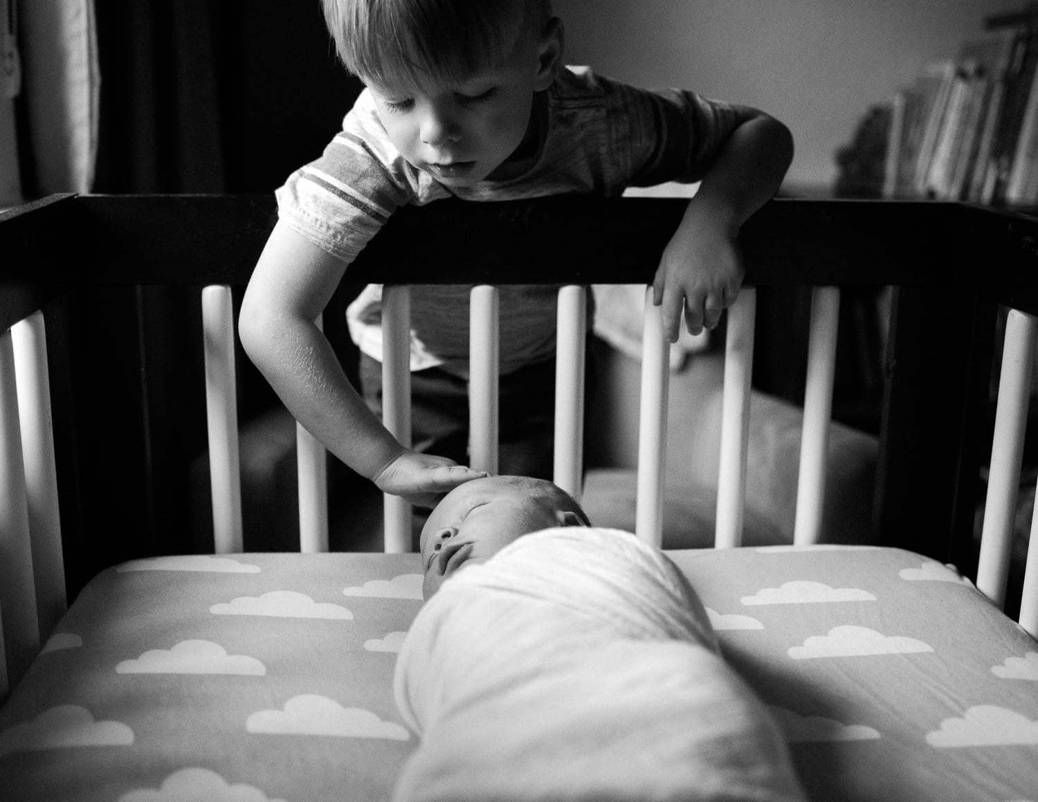 Candid portrait of big brother and newborn.