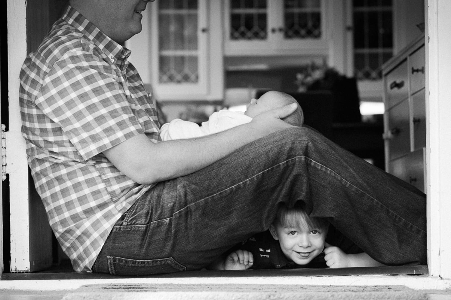 Candid Portrait Boy with Dad and Baby