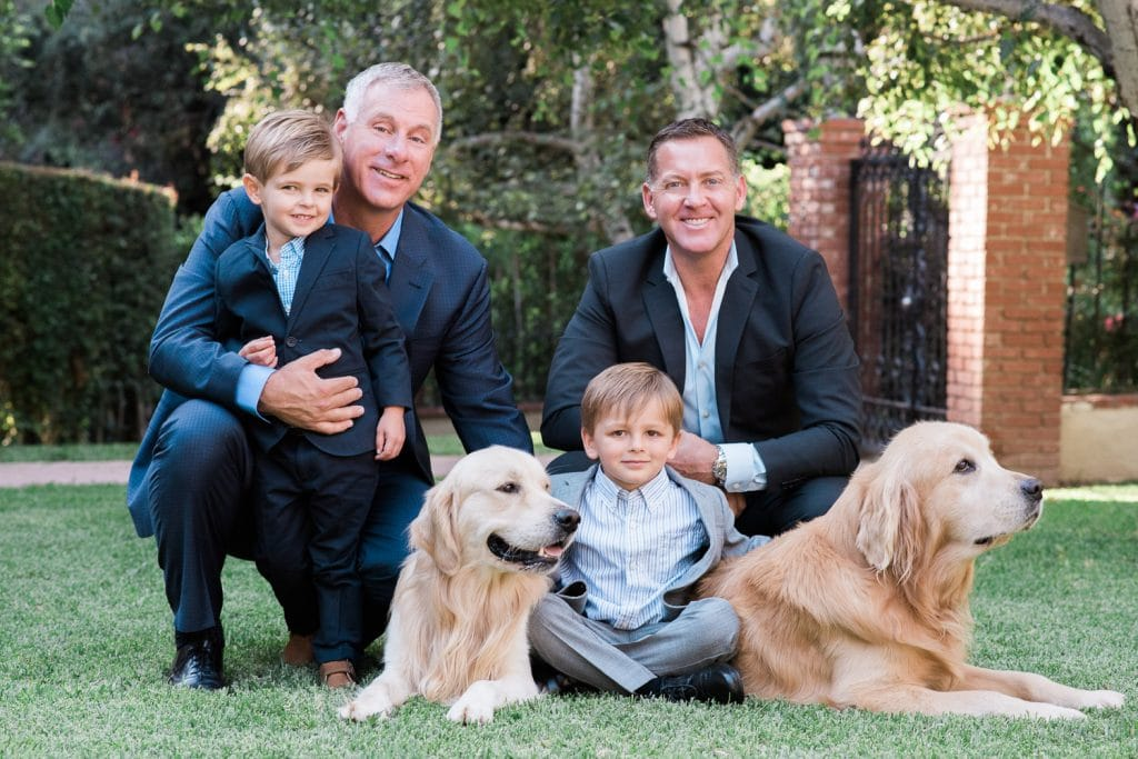 Family photo with twin boys and dogs