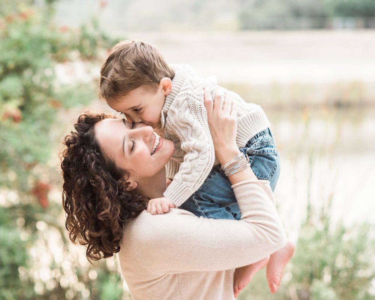 Mother-lifting-toddler-up