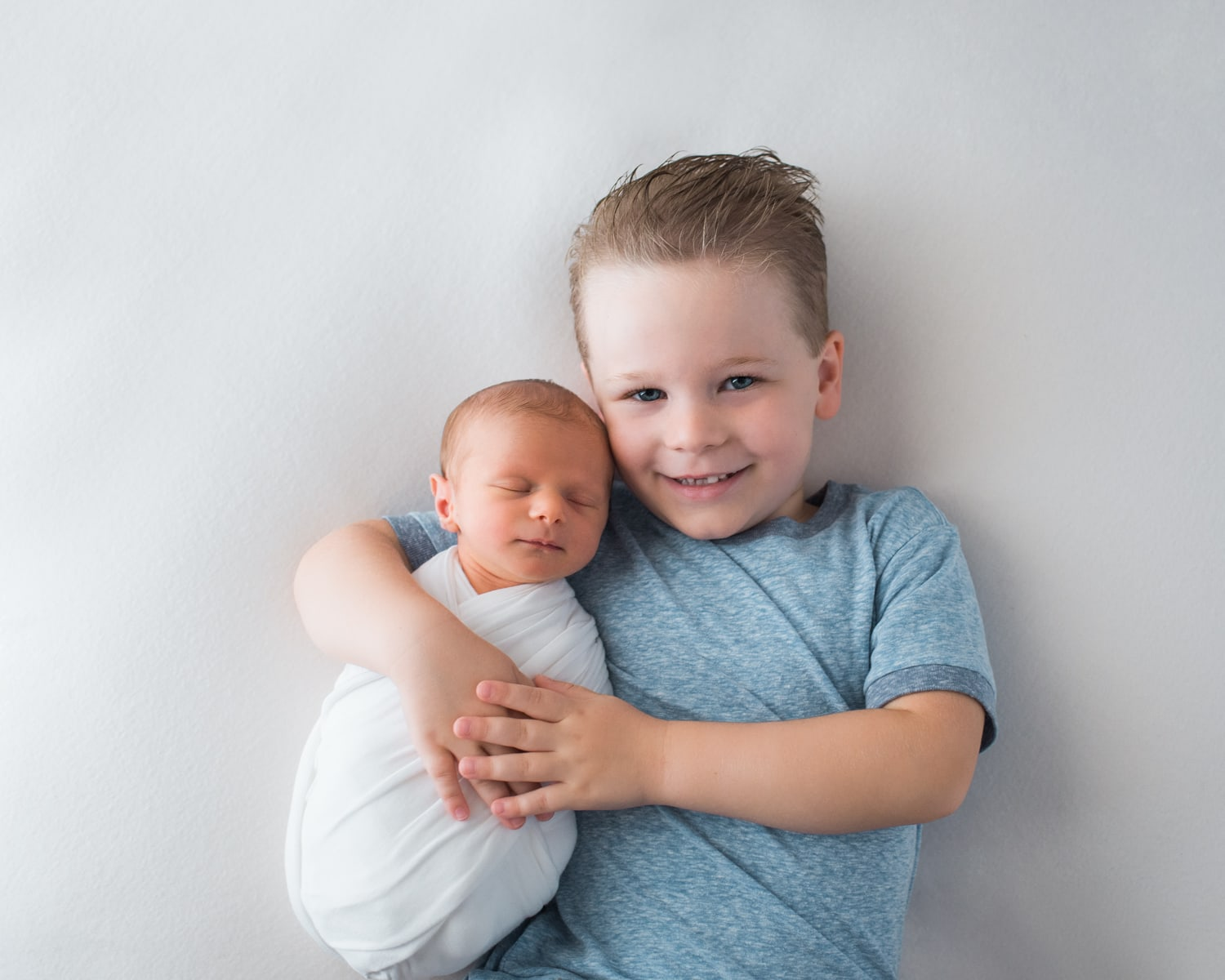 brother holding newborn