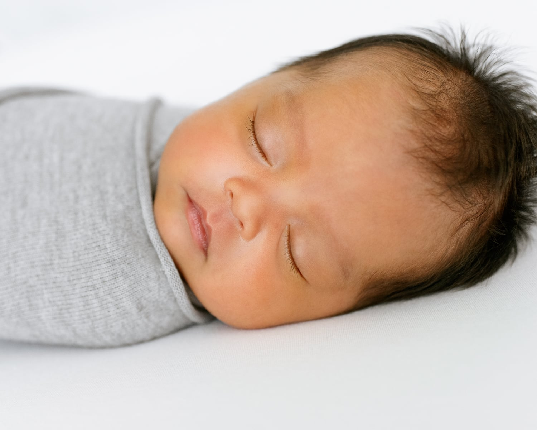 portrait of swaddled newborn